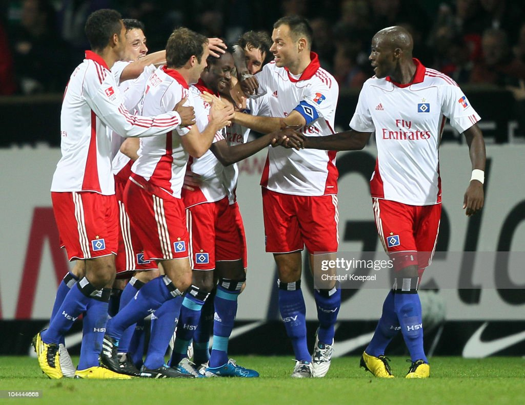 The team of Hamburg celebrates the second goal of <a gi-track='captionPersonalityLinkClicked' href=/galleries/search?phrase=Jonathan+Pitroipa&family=editorial&specificpeople=685230 ng-click='$event.stopPropagation()'>Jonathan Pitroipa</a> of Hamburg (3rd R) during the Bundesliga match between Werder Bremen and Hamburger SV at the Weser Stadium on September 25, 2010 in Bremen, Germany.