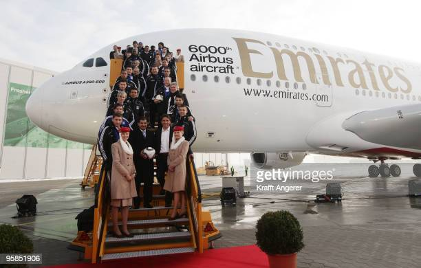 The team of Hamburger SV pose in front of the aircraft during the hand over of the A380 to the Emirates airline on January 18 2010 in Hamburg...