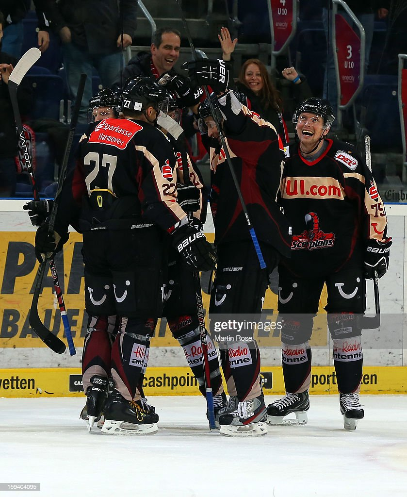 The team of Hannover celebrate their 3rd goal during the DEL match between Hannover Scorpions and Straubing Tigers at TUI Arena on January 13, 2013 in Hanover, Germany.