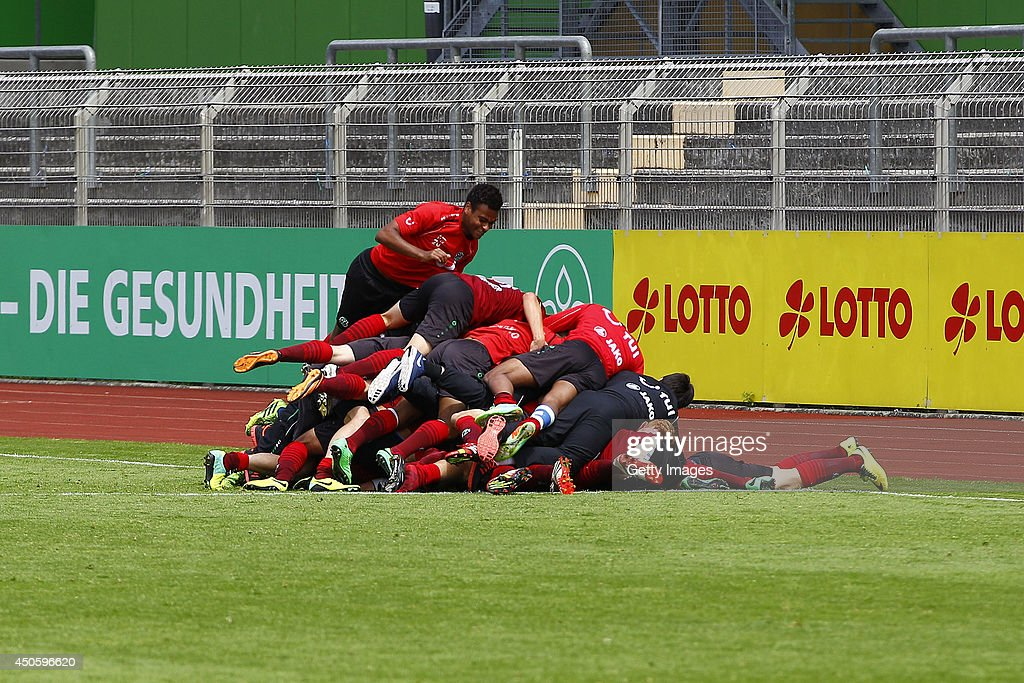 The Team of Hannover celebrates during the A Juniors Bundesliga Semi Final between U19 VfL Wolfsburg and U19 Hannover 96 at Stadion am Elsterweg on June 14, 2014 in Wolfsburg, Germany.