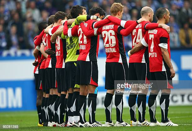 The team of Hannover stands up for a minute's silence after the death of Robert Enke during the Bundesliga match between FC Schalke 04 and Hannover...