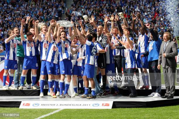 The team of Hertha BSC Berlin celebrate winning the championship with the trophy after the Second Bundesliga match between Hertha BSC Berlin and FC...
