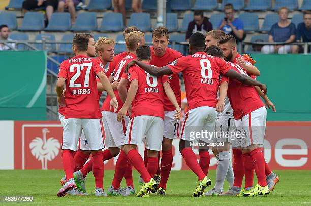 The team of Hertha BSC celebrates during the match between Arminia Bielefeld and Hertha BSC on August 10 2015 in Bielefeld Germany