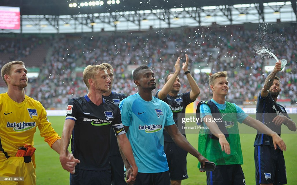 The team of Hertha BSC celebrates winning the Bundesliga match between FC Augsburg and Hertha BSC at WWK-Arena on August 15, 2015 in Augsburg, Germany.
