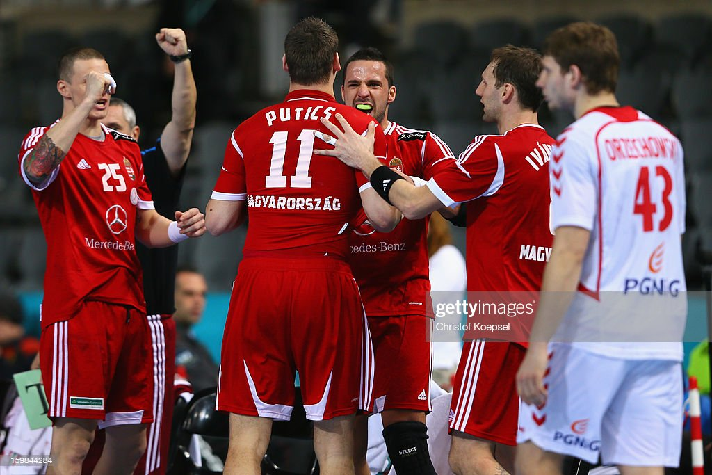 The team of Hungary celebrates and Robert Orzechowski of Poland (R) looks dejected during the round of sixteen match between Hungary and Poland at Palau Sant Jordi on January 21, 2013 in Barcelona, Spain.