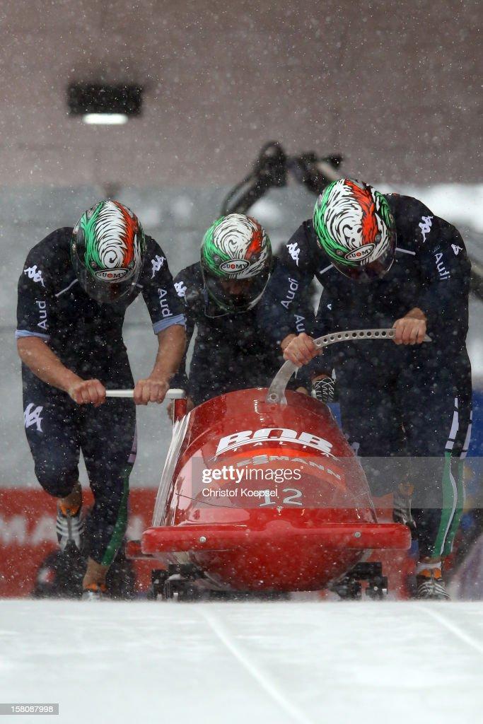 The team of Italy 1 runs Simone Bertazzo, Samuele Romanini, Francesco Costa and Luca Zazzera sprint during the four men's bob competition during the FIBT Bob & Skeleton World Cup at Bobbahn Winterberg on December 9, 2012 in Winterberg, Germany.