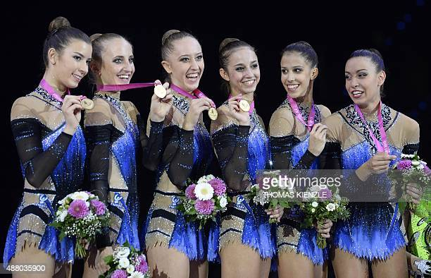 The team of Italy celebrates after winning the gold medal in the groups ribbon final at the World Rhythmic Gymnastics Championships in Stuttgart...