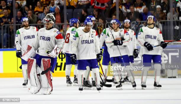 The team of Italy looks dejected after the 2017 IIHF Ice Hockey World Championship game between Slovakia and Italy at Lanxess Arena on May 6 2017 in...