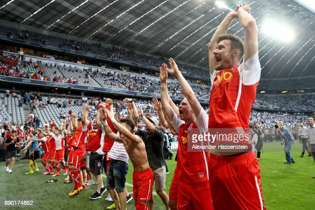 The team of Jahn Regensburg celebrate after the Second Bundesliga Playoff second leg match betweenTSV 1860 Muenchen and Jahn Regensburg at Allianz...