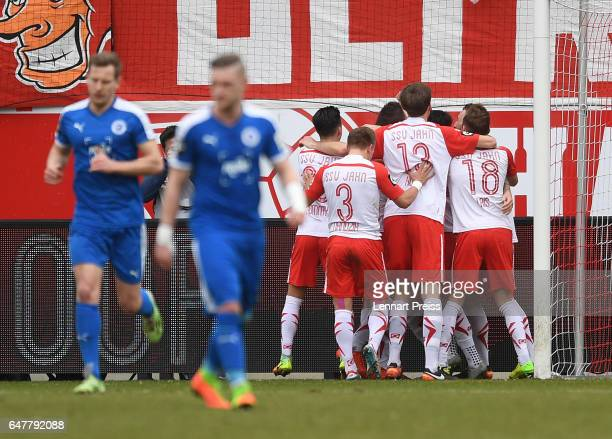 The team of Jahn Regensburg celebrates it's first goal during the 3 Liga match between Jahn Regensburg and Sportfreunde Lotte at Continental Arena on...