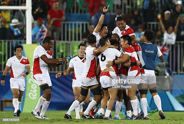 The team of Japan celebrate after the Men's Quarterfinal 2 Match 22 between Japan and France on Day 5 of the Rio 2016 Olympic Games at Deodoro...