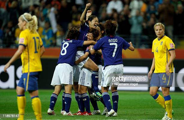 The team of Japan celebrate Homare Sawa scoring a goal during the FIFA Women's World Cup Semi Final match between Japan and Sweden at the FIFA World...