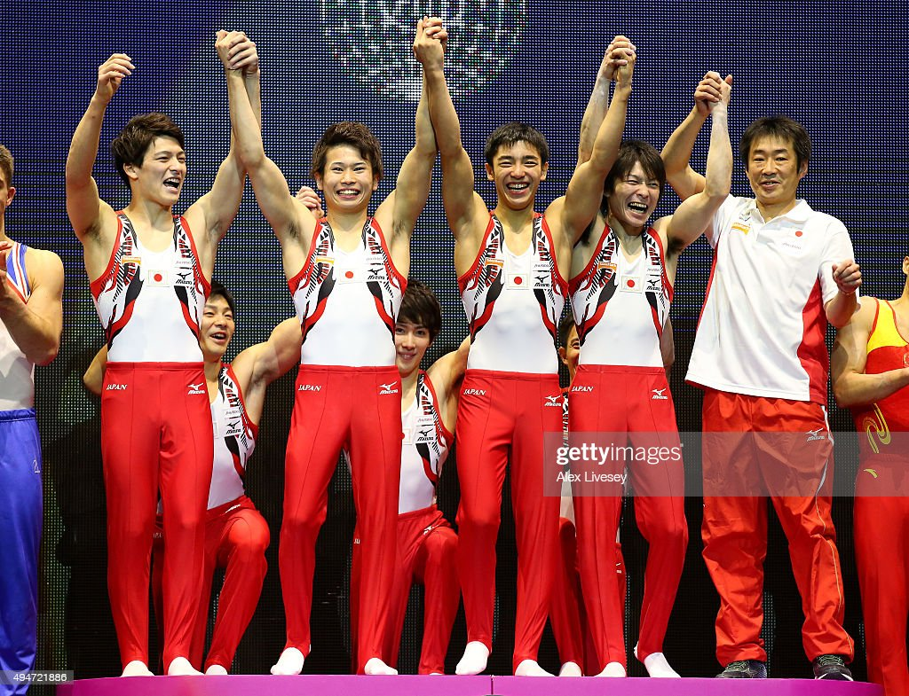 The team of Japan celebrate winning Gold during day six of the 2015 World Artistic Gymnastics Championships at The SSE Hydro on October 28 2015 in...