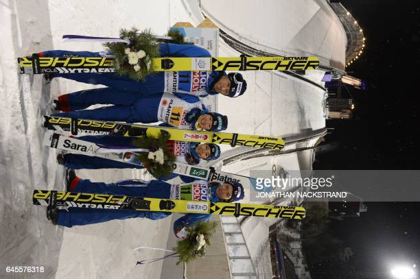 The team of Japan Daiki Ito Yuki Ito Sara Takanashi and Taku Takeuchi pose for photographers after the ski jumping mixed normal hill team competition...