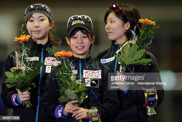 The team of Japan poses during the flower ceremony after winning the ladies team pursuit during Day 2 of the ISU Speed Skating World Cup at the Max...