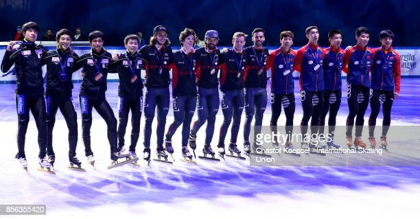 The team of Japan poses during the medal ceremony after winning the 3rd place the team of Canada poses during the medal ceremony after winning the...