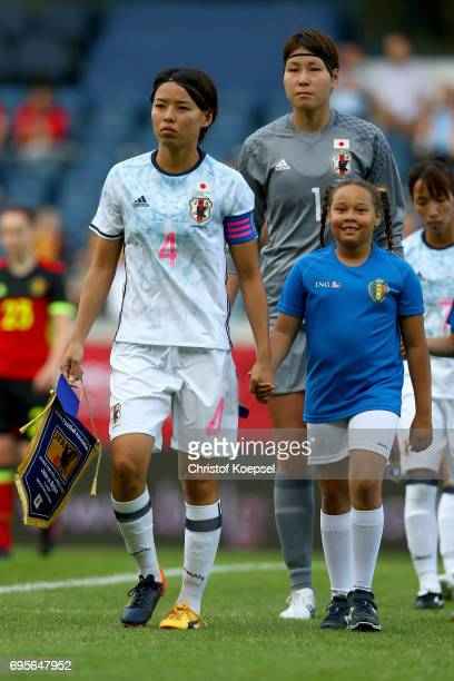 The team of Japan with Saki Kumagai enters the pitch prior to the Women's International Friendly match between Belgium and Japan at Stadium Den Dreef...