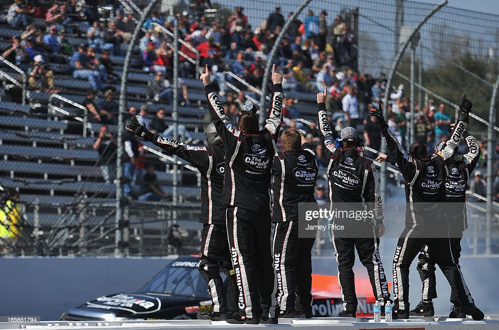 The team of Johnny Sauter, driver of the #98 Carolina Nut Co./Curb Records Toyota, celebrates winning the NASCAR Camping World Truck Series Kroger 250 on April 6, 2013 at Martinsville Speedway in Ridgeway, Virginia.