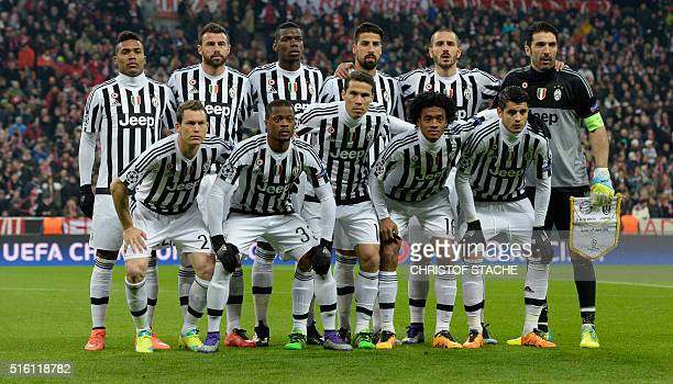 The team of Juventus with Juventus' defender from Brazil Alex Sandro Juventus' midfielder from Italy Claudio Marchisio Juventus' midfielder from...