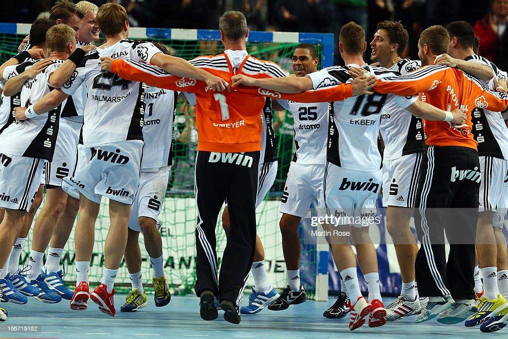 The team of Kiel celebrate after the DKB Handball Bundesliga match between THW Kiel and SG Flensburg-Handewitt at Sparkassen Arena on November 7, 2012 in Kiel, Germany.