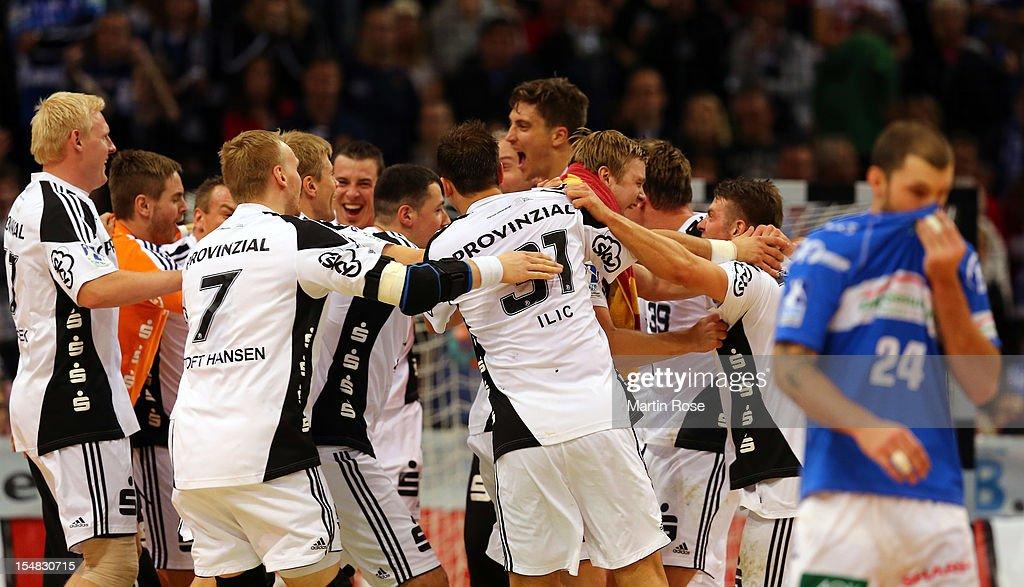 The team of Kiel celebrate after winning the DKB Handball Bundesliga match between HSV Hamburg and THW Kiel at the O2 World on October 27, 2012 in Hamburg, Germany.
