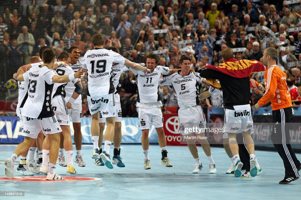The team of Kiel celebrate after winning the Toyota Handball Bundesliga match between THW Kiel and SC Magdeburg at Sparkassen Arena on May 1, 2012 in Kiel, Germany.