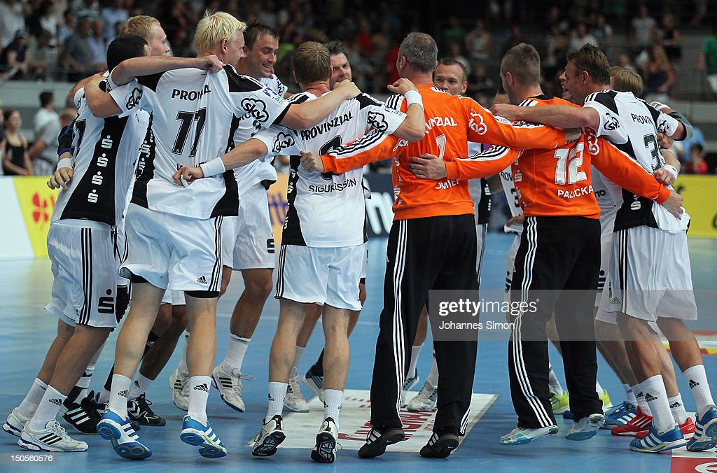 The team of Kiel celebrates after winning the Handball Supercup match between THW Kiel and SG Flensburg Handewitt at Olympia Eishalle on August 21, 2012 in Munich, Germany.