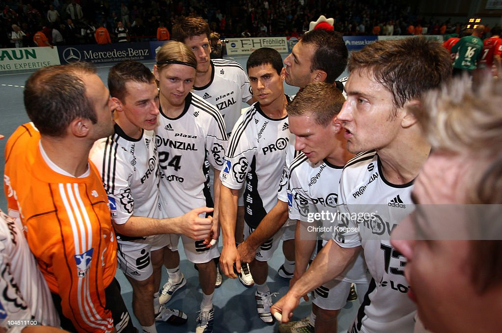 The team of Kiele celebrates the 32-23 victory after the Toyota Handball Bundesliga match between MT Melsungen and THW Kiel at the Rotehnbach Hall on September 28, 2010 in Kassel, Germany.