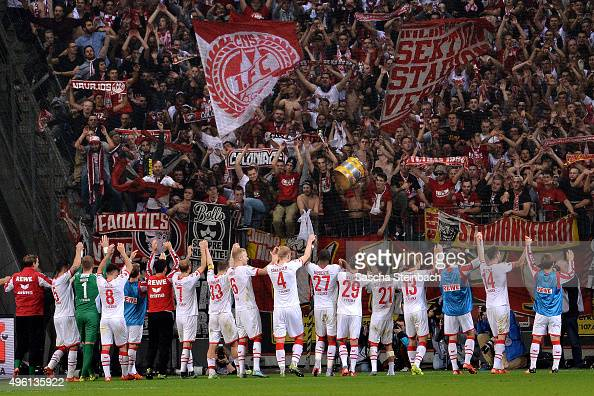 The team of Koeln celebrates in front of the Koeln stand after winning their Bundesliga match against Bayer Leverkusen at BayArena on November 7 2015...