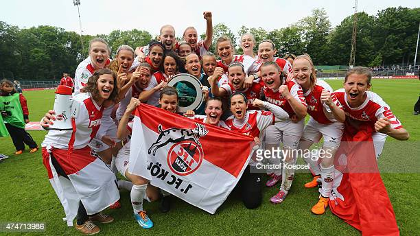 The team of Koeln celebrates winning the Women's 2nd Bundesliga South after the Women's 2nd Bundesliga match between 1 FC Koeln and Bayern Muenchen...
