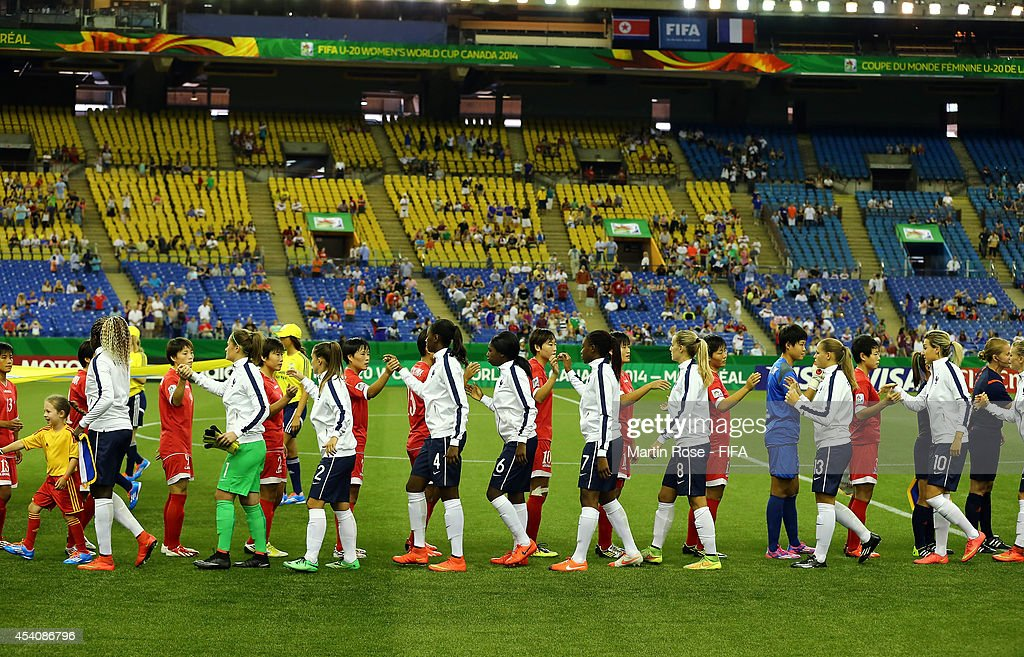 The team of Korea DPR and of France line up before the FIFA U-20 Women's World Cup 2014 3rd place playoff match between Korea DPR and France at Olympic Stadium on August 24, 2014 in Montreal, Canada.