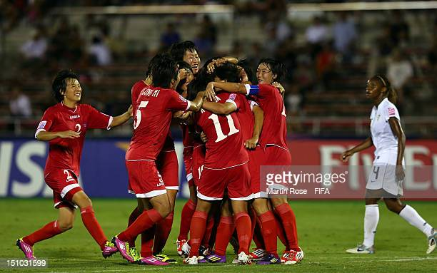 The team of Korea DPR celebrate their equalizing goal during the FIFA U20 Women's World Cup Japan 2012 Quarter Final match between Korea DPR and USA...