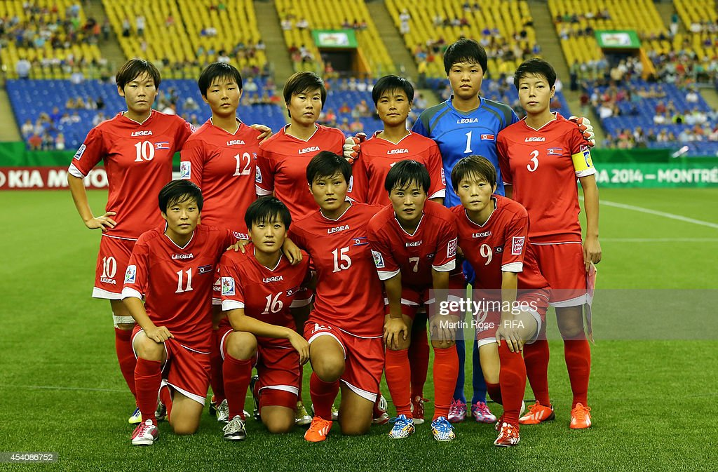 The team of Korea DPR line up before the FIFA U-20 Women's World Cup 2014 3rd place playoff match between Korea DPR and France at Olympic Stadium on August 24, 2014 in Montreal, Canada.