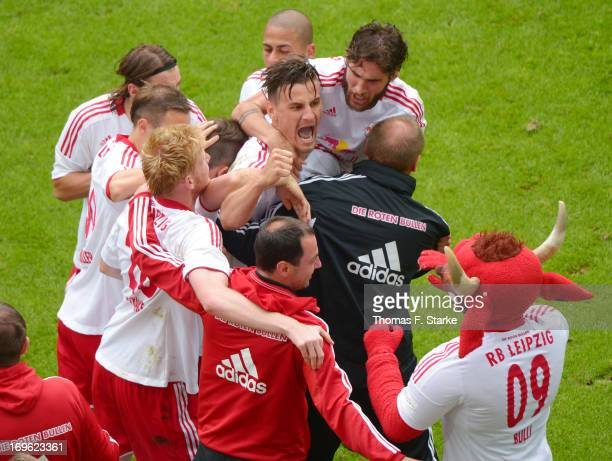 The team of Leipzig celebrates with scorer Stefan Kutschke their first goal during the Regionalliga Playoff First Leg match between between...