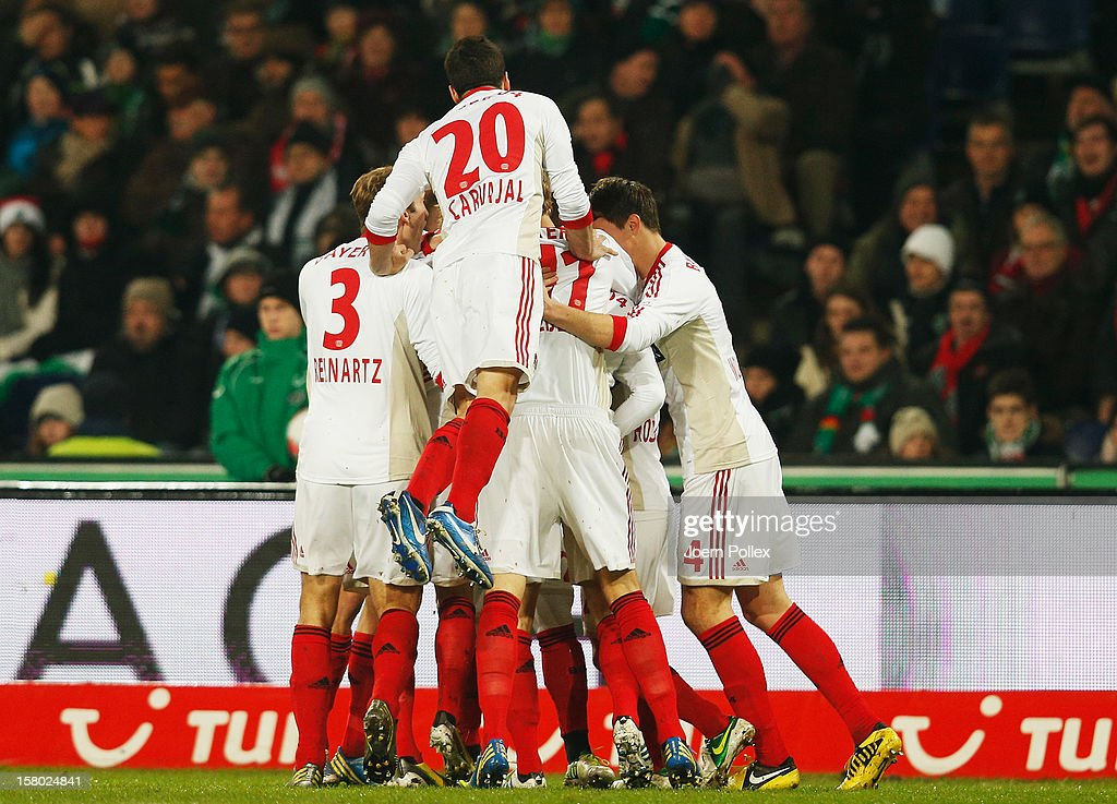 The team of Leverkusen celebrates after <a gi-track='captionPersonalityLinkClicked' href=/galleries/search?phrase=Gonzalo+Castro&family=editorial&specificpeople=605388 ng-click='$event.stopPropagation()'>Gonzalo Castro</a> scoed his team's first goal during the Bundesliga match between Hannover 96 and Bayer 04 Leverkusen at AWD Arena on December 9, 2012 in Hannover, Germany.