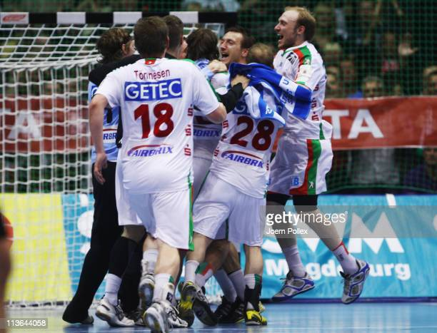 The team of Magdeburg celebrates after winning the Toyota Handball Bundesliga match between SC Magdeburg and THW Kiel at the Boerdeland Hall on May 4...