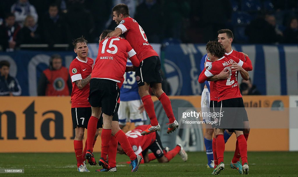 The team of Mainz celebrate after winning the DFB cup round of sixteen match between FC Schalke 04 and FSV Mainz 05 at Veltins-Arena on December 18, 2012 in Gelsenkirchen, Germany.
