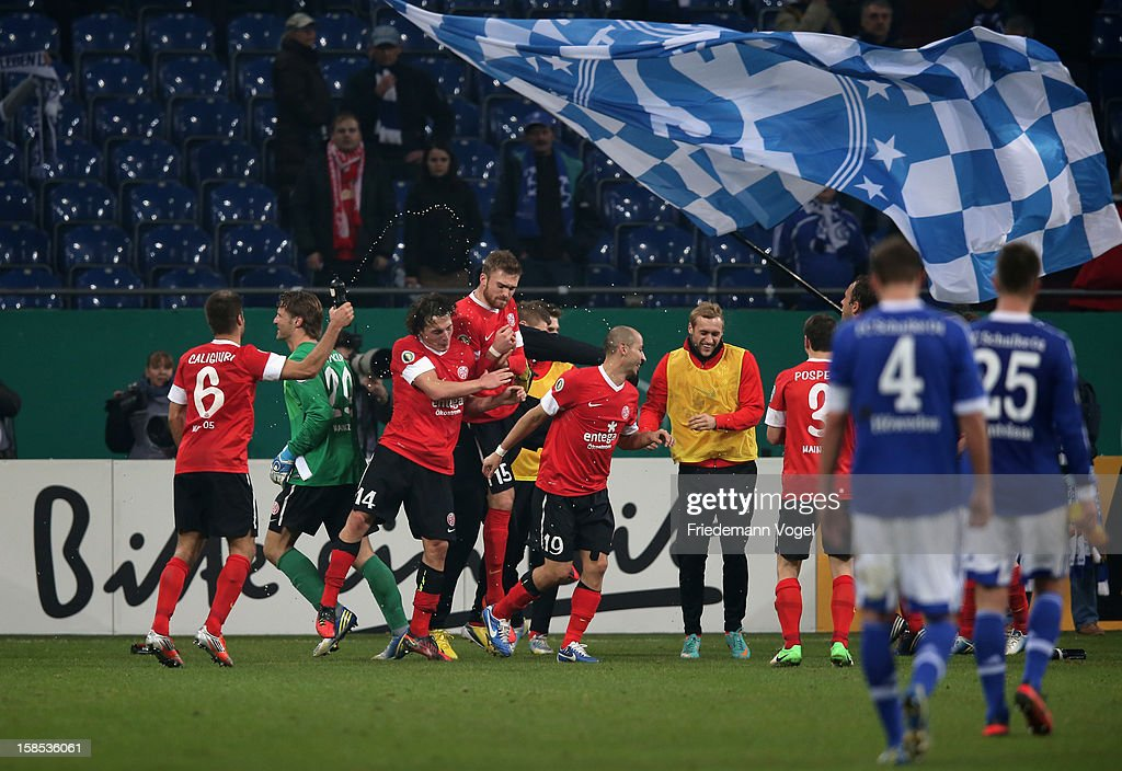 The team of Mainz celebrates after winning the DFB cup round of sixteen match between FC Schalke 04 and FSV Mainz 05 at Veltins-Arena on December 18, 2012 in Gelsenkirchen, Germany.