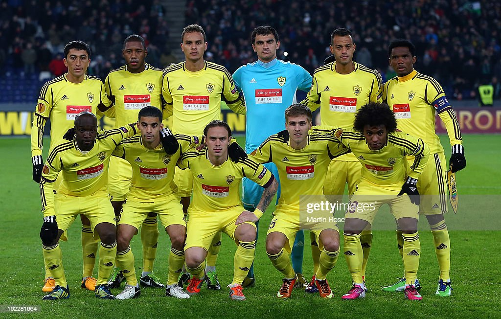 The team of Makhachkala battle for the ball during the UEFA Europa League Round of 32 second leg match between Hannover 96 and Anji Makhachkala at AWD Arena on February 21, 2013 in Hannover, Germany.