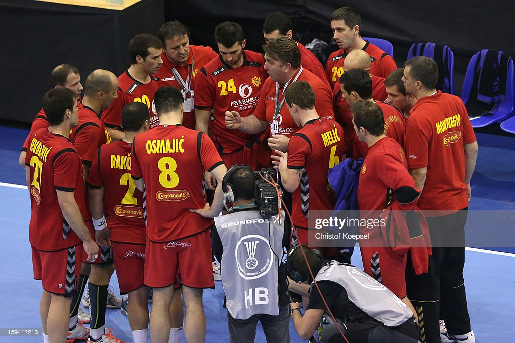 The team of Montenegro with head coach Zoran Kastratovic (C) comes together during the premilary group A match between Montenegro and France at Palacio de Deportes de Granollers on January 13, 2013 in Granollers, Spain.