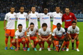 The team of Montpellier poses prior to the UEFA Champions League group B match between FC Schalke 04 and Montpellier Herault SC at VeltinsArena on...