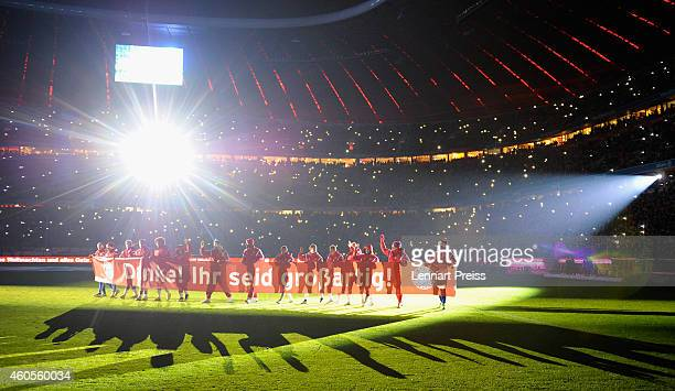 The team of Muenchen says 'thank you' to their fans with a banner reading 'Thank you You are great' after the Bundesliga match between FC Bayern...