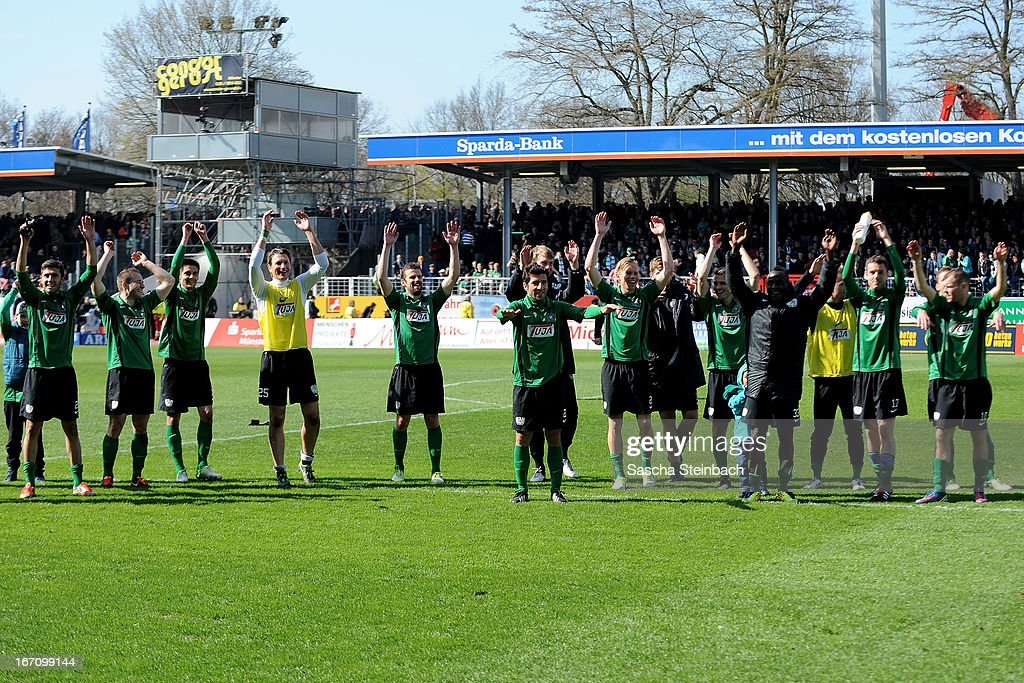 The team of Muenster celebrate after the 3. Liga match between Preussen Muenster and Karlsruher SC at Preussenstadion on April 20, 2013 in Muenster, Germany.