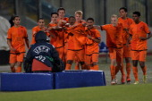 The team of Netherlands celebrates after scoring the opening goal during the UEFA Under17 European Championship 2014 semi final match between...