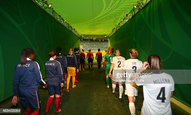 The team of New Zealand and of France walk onto the pitch before the FIFA U20 Women's World Cup 2014 group D match between New Zealand and France at...