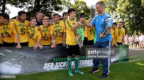 The team of Niedersachsen celebrates with the trophy after winning the U15 Federal Cup at Sport School Wedau on June 30 2015 in Duisburg Germany