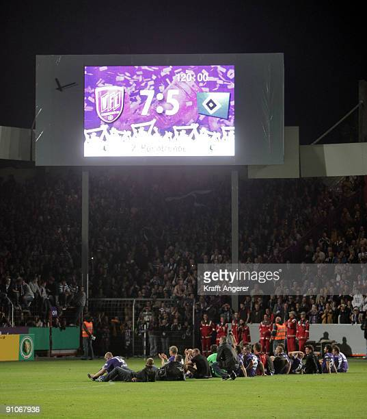 The team of Osnabrueck celebrates the DFB Cup second round match between VfL Osnabrueck and Hamburg SV at Osnatel Arena on September 23 2009 in...