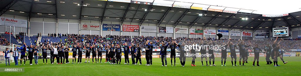 The Team of Paderborn celebrate promotion during the match between SC Paderborn and VFR Aalen at Benteler Arena on May 11 2014 in Paderborn Germany