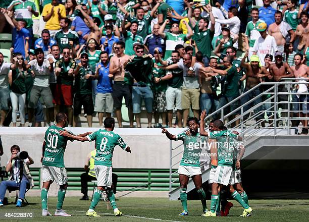 The team of Palmeiras celebrates scoring the third goal during the match between Palmeiras and Flamengo for the Brazilian Series A 2015 at Allianz...