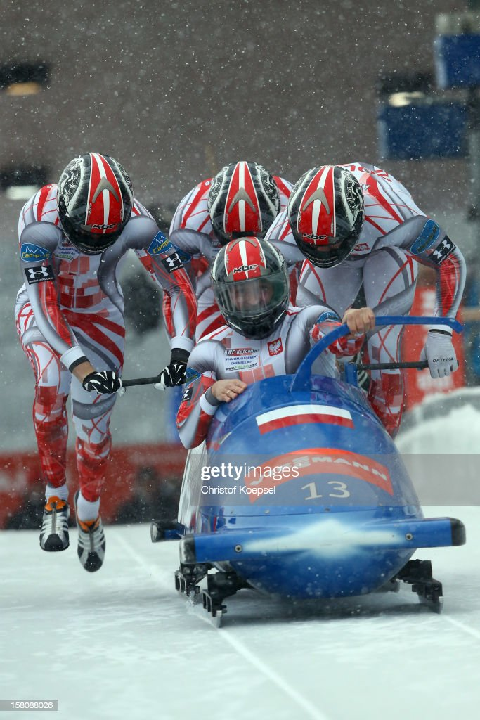 The team of Poland 1 with Dawid Kupczyk, Patryk Pieczarka, Marcin Niewiara and Pawel Mroz sprint during the four men's bob competition during the FIBT Bob & Skeleton World Cup at Bobbahn Winterberg on December 9, 2012 in Winterberg, Germany.